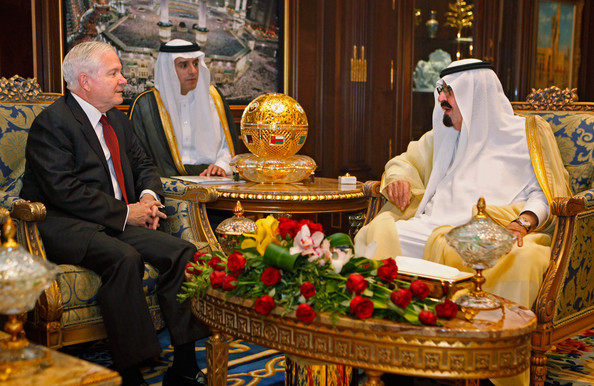 Ambassador Adel Al-Jubeir between King Abdullah Al-Saud and former U.S. Defense Secretary Robert Gates