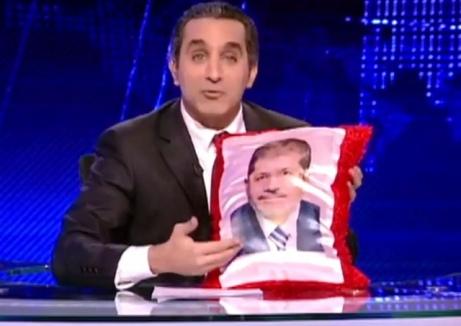 Youssef satirizing former President Mohammed Morsi in 2012.