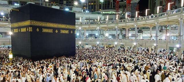People performing one of Islam's rituals, circling Al-Kaaba Al-Musharrafah (The Holy Kaaba) at Al-Masjid Al-Ḥaram (The Great Mosque), Makkah Al-Mukarramah, Saudi Arabia.