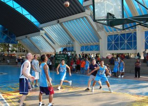 The Philippine National Police basketball team and crew of the USS Connecticut submarine play a friendly basketball game in Olongapo City.